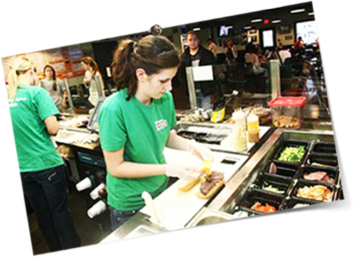 Employees working the sandwich line